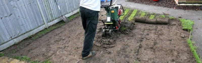 Placing synthetic turf in soil